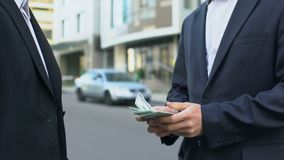 Buyer of vehicle paying money to owner of auto, sale of car without intermediary stock footage