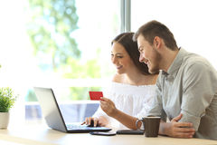 Buyers buying online with credit card Royalty Free Stock Image