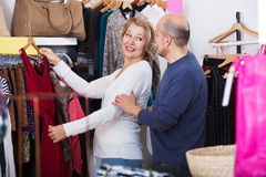 The buyers chosing dresses Royalty Free Stock Photos