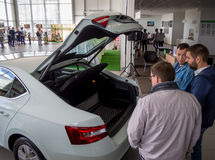 Buyers evaluate the trunk of a new car Royalty Free Stock Images