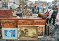 Buyers of popular art and flea market with bargains, antique stuff in mess of vintage decor and retro details. BRUSSELS, BELGIUM - APR 3: Buyers of popular art Stock Photography
