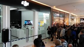 Buyers stand in line waiting for the opening of DJI Store. Moscow, Russia - April 1, 2017: Buyers stand in line waiting for the opening of DJI Authorized Store stock video footage