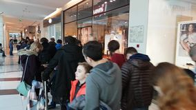 Buyers stand in line waiting for the opening of DJI Store. Moscow, Russia - April 1, 2017: Buyers stand in line waiting for the opening of DJI Authorized Store stock video
