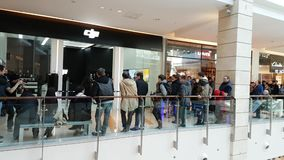 Buyers stand in line waiting for the opening of DJI Store. Moscow, Russia - April 1, 2017: Buyers stand in line waiting for the opening of DJI Authorized Store stock footage