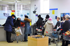 Buyers stand in turn in cash desk in clothing store. Tyumen Stock Photo