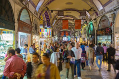 Buyers of t tourists on the Grandee Bazare in Istanbul. Royalty Free Stock Image