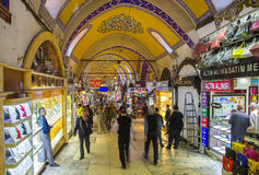 Buyers of t tourists on Grandee Bazare in Istanbul. Buyers of t tourists on the Grandee Bazare in Istanbul. Grand-Bazar - one of the largest covered markets in Royalty Free Stock Photography