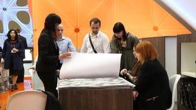 Buyers in wallpaper shop stock video footage