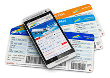 Buying air tickets online. Creative abstract business air travel, mobility and communication concept: modern touchscreen smartphone or mobile phone with airline Royalty Free Stock Images