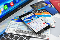 Buying air tickets online via smartphone. Creative abstract business air travel, mobility and communication concept: modern touchscreen smartphone or mobile Royalty Free Stock Photography