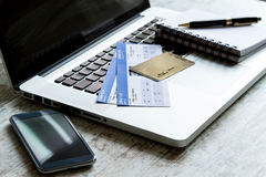Buying Airline tickets. On line with a credit card Royalty Free Stock Photo