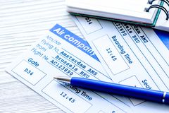Buying airline tickets online with credit cards on table backgro. Buying airline tickets online for travel with credit cards and copybook on wooden table Royalty Free Stock Photography