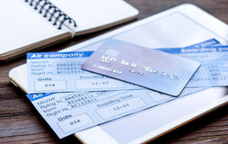 Buying airline tickets online with credit cards on table background Stock Photos