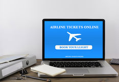 Buying airline tickets online on laptop.  royalty free stock photography