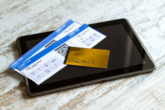 Buying Airline tickets on a tablet. Buying airline tickets on line with a credit card Stock Photography