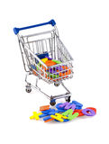 Buying the alphabet. Shopping cart with colored letters on a white background Royalty Free Stock Photography