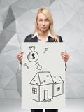 Buying an apartment. Businesswoman holding placard with buying an apartment Stock Images