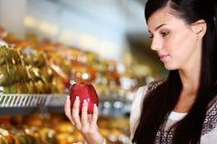 Buying apple Stock Photography