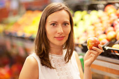 Buying apple in a grocery store Stock Photo