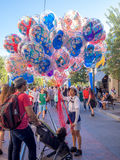 Buying balloons at Disney California Adventure Park Royalty Free Stock Photography