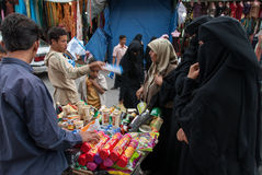 Buying biscuits in Yemen Stock Images
