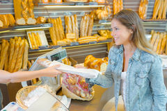 Buying bread from bakery Royalty Free Stock Photos