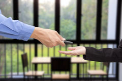 Buying Car. Businessman giving a key car to businesswoman. Royalty Free Stock Photo