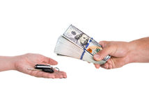 Buying a car. Female hand holding a car key. Man holding dollars Stock Photos