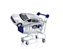 Buying car. Shopping cart with car over white Royalty Free Stock Photos