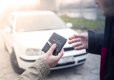 Buying a car. Transmission car documents and keys to close the deal after buying a car stock image