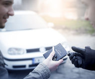 Buying a car. Transmission car documents and keys to close the deal after buying a car royalty free stock photo