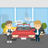 Buying cars at showroom. Sale agent and buyer with red car Stock Photography