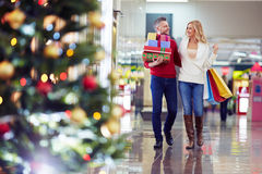Buying Christmas gifts Stock Images