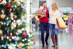 Buying Christmas gifts Royalty Free Stock Image