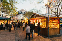 Buying Christmas Market souvenirs from stall business Royalty Free Stock Photography
