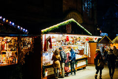 Buying Christmas Toys in Strasbourg Christmas Market Royalty Free Stock Photos