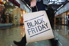 Buying craze. Human with paperbag shopping on Black Friday stock photos