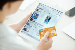 Buying on eBay with Apple iPad Air. KIEV, UKRAINE - JUNE 27, 2014: Person holding a credit card and trying to buy a new Apple iPhone 5 with eBay application on a Stock Images