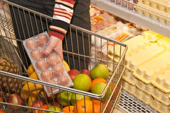 Buying eggs. In a supermarket Stock Photo