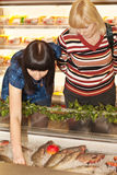 Buying fish. In supermarket on june 2009 Stock Images