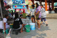 Buying fishes and birds. KORAT, THAILAND - JANUARY 16 : The unidentified tourists are buying fishes and birds on January 16, 2012 at Thao Suranari monument plaza stock image