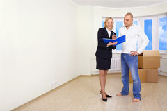 Buying a flat. A man is signing a contract for buying a house Royalty Free Stock Photos