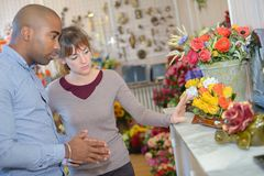 Buying flowers for dead relative. Buying flowers for a dead relative Royalty Free Stock Photos
