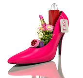 Buying and flowers inside shoes Stock Photos