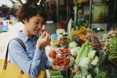 Buying fresh tomatoes Stock Photo