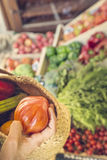 Buying fresh vegetables in a market on a pram Stock Photography