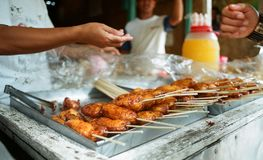 Buying fried banana, streetfood. Stock Photo