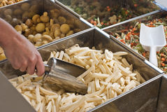 Buying frozen French fries. In supemarkete Royalty Free Stock Photos