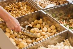 Buying frozen mushrooms Royalty Free Stock Photos