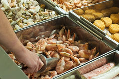 Buying frozen shrimps. In  supermarket Stock Images